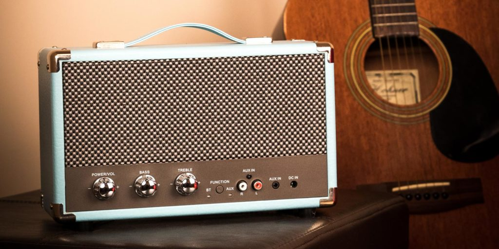 Sky blue westwood speaker with guitar in background