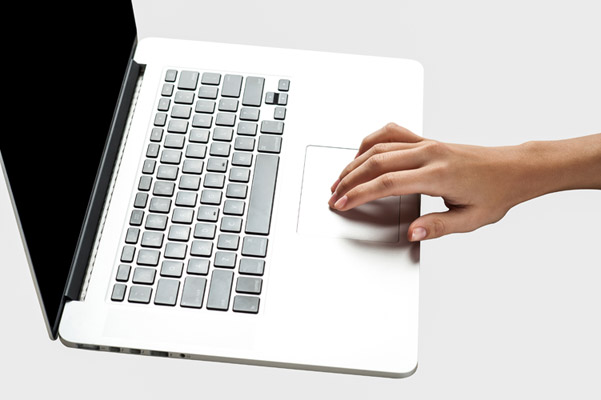 Hand using laptop trackpad