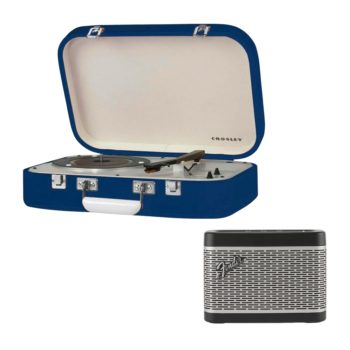 Blue Crosley Coupe record player with open lid next to black and silver Fender Newport speaker