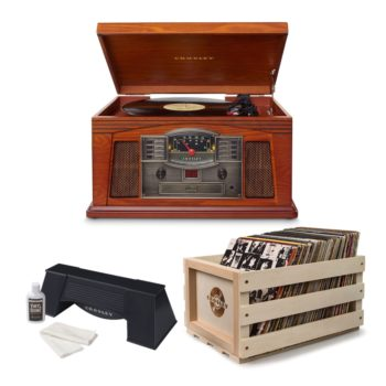 Wooden Crosley Lancaster entertainment unit with turntable shown above a Crosley record cleaner and wooden crate full of vinyl