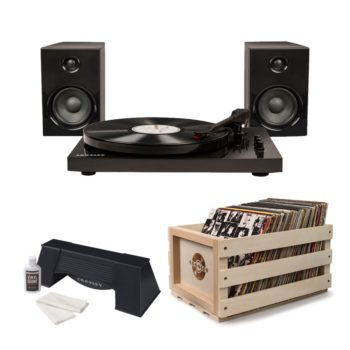 Modern black Crosley T100 turntable record player with matching black speakers pictures with wooden crossly crate and spinning cleaner
