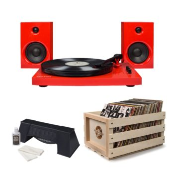 Bright red Crosley T100 turntable record player with black dials and tonearm shown above wooden Crosley Crate and plastic Crosley vinyl record spinning cleaner