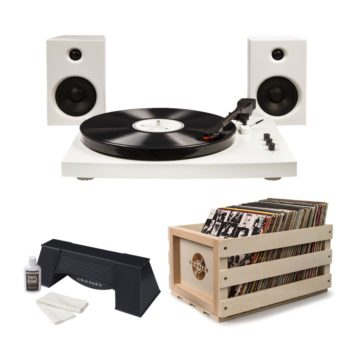 Contemporary white T100 Crosley turntable record player with black features shown in a bundle with spinning record cleaner and wooden record storage crate