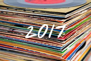 Stack of albums with 2017 on them
