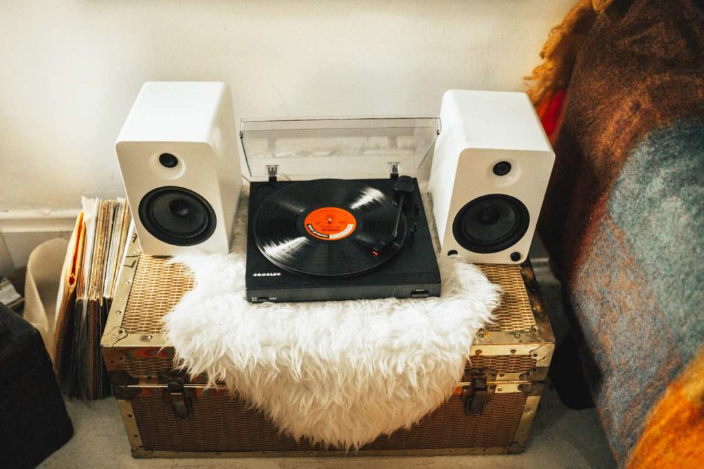 Crosley Turntable sitting with 2 speakers by its side