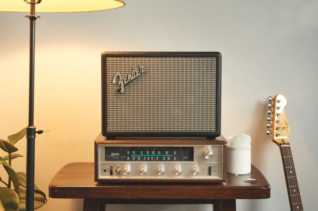 Large Fender Bluetooth speaker shown sitting on over amplifier