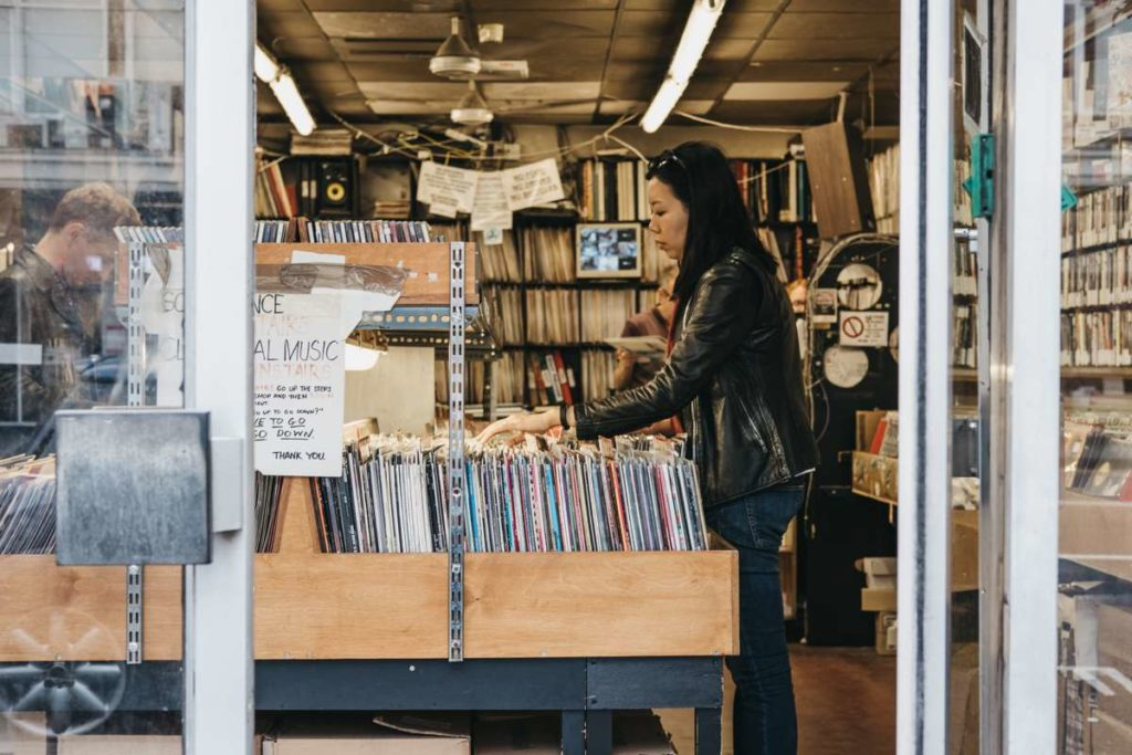 Woman browsing through vinyl records in an Australian store