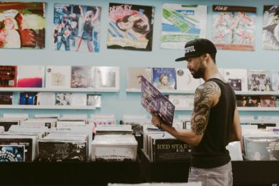 Guy in record store browsing vinyl