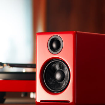 Lifestyle photo of red Audioengine 2+ powered speakers