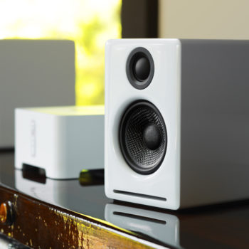 Lifestyle image of white Audioengine 2+ powered speaker