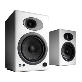 Front angled image of white Audioengine 5+ powered bookshelf speakers