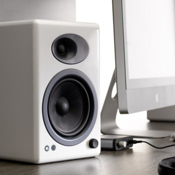 Lifestyle photo of white Audioengine 5+ Powered Bookshelf Speaker